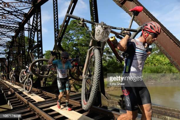 Ricardo Rouillon Villa of Costa Rica carries his bike across a railroad bridge during Day 3 of La Ruta de Los Conquistadores on November 3 2018 in...