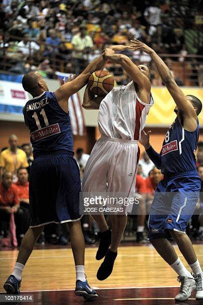 Ricardo Sanchez and Angel Vasallo of Puerto Rico vie for the ball with Noe Alonzo of Mexico during the XXI Central American Caribbean Games...
