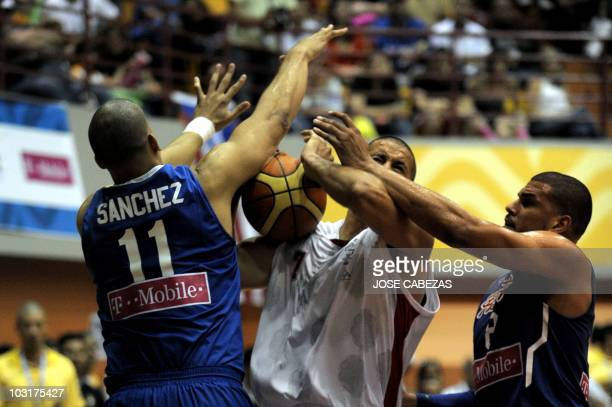 Ricardo Sanchez and Angel Vasallo of Puerto Rico vie for the ball with Noe Alonzo of Mexico during the XXI Central American & Caribbean Games...