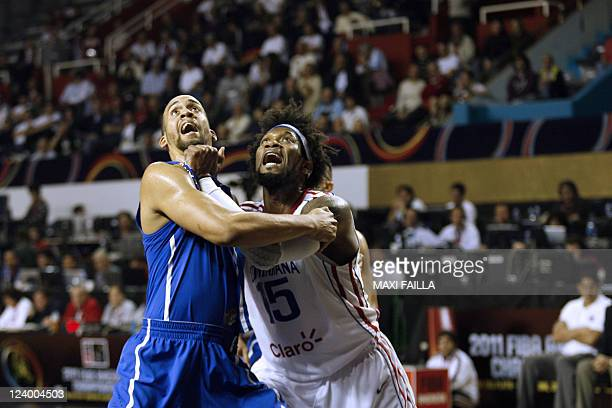 Ricardo Sanchez of Puerto Rico and Jack Michael Martinez of the Dominican Republic fight for a rebound during the Dominican Republic vs Puerto Rico...