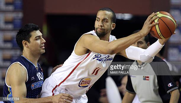 Ricardo Sanchez of Puerto Rico control the ball next to Carlos Delfino of Argentina during the qualifying round of the 2011 FIBA Americas...