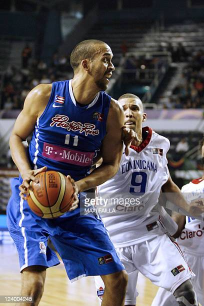 Ricardo Sanchez of Puerto Rico is marked by Francisco Garcia of the Dominican Republic during the Dominican Republic vs Puerto Rico 2011 FIBA...