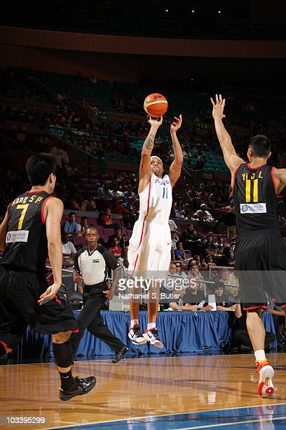Ricardo Sanchez of Puerto Rico shoots against Yi Jianlian of China at Madison Square Garden on August 15, 2010 in New York City. NOTE TO USER: User...