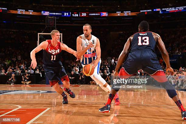 Ricardo Sanchez of the Puerto Rico National Team drives against Mason Plumlee of the USA Basketball Men's National Team on August 22 2014 at Madison...