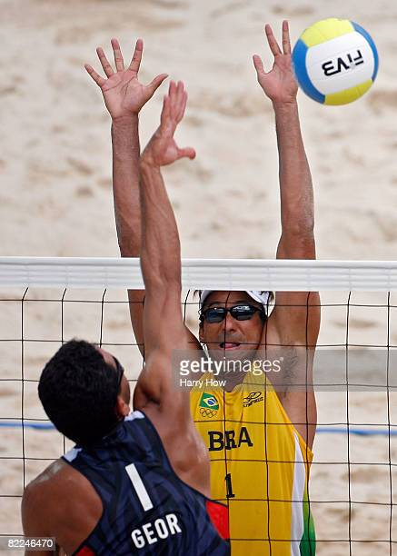 Ricardo Santos of Brazil goes up for a block against Jorge Terceiro of Georgia during the beach volleyball event at the Chaoyang Park Beach...