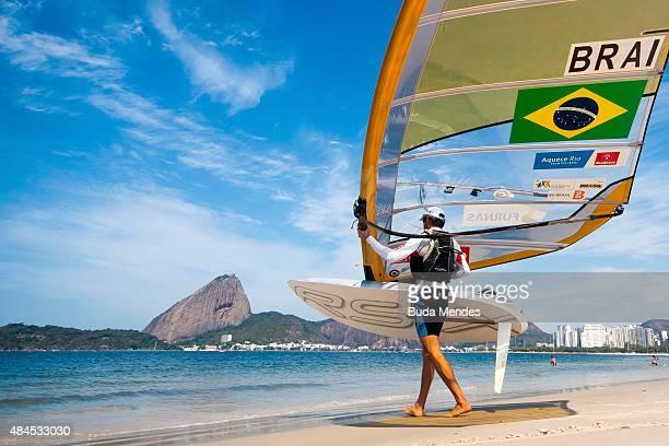 Ricardo Santos of Brazil prepares for sail in the RSX class on the Pao de Acucar course during the International Sailing Regatta Aquece Rio Test...