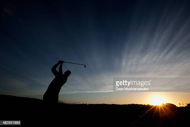 Ricardo Santos of Portugal hits a practice shot on the driving range as the sun rises during day two of the NH Collection Open held at La Reserva de...