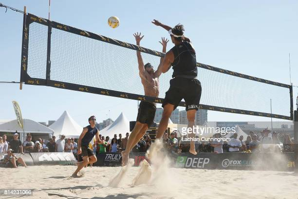 Ricardo Santos spikes the ball past Jeremy Casebeer during day 3 of the AVP San Francisco Open at Pier 3032 on July 8 2017 in San Francisco California
