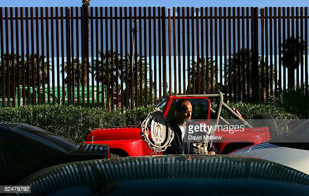 Ricardo sells religious art to drivers waiting in line to enter the United States from Mexico March 25 2005 near Calexico California Since the launch...