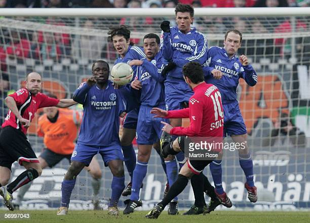 Ricardo Sousa of Hannover shoots a free kick at goalduring the Bundesliga match between Hanover 96 and FC Schalke 04 at the AWD Arena on March 4 2006...
