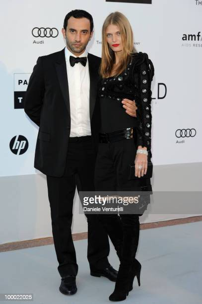 Ricardo Tisci and Malgosia Bela arrives at amfAR's Cinema Against AIDS 2010 benefit gala at the Hotel du Cap on May 20, 2010 in Antibes, France.