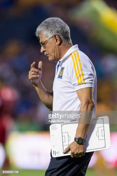 Ricardo 'Tuca' Ferretti coach of Tigres gets in the field during the seventh round match between Tigres UANL and Lobos BUAP as part of the Torneo...