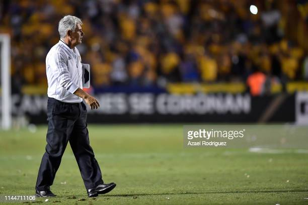 Ricardo 'Tuca' Ferretti, coach of Tigres, gets out of the field at the end of the final first leg match between Tigres UANL and Monterrey as part of...