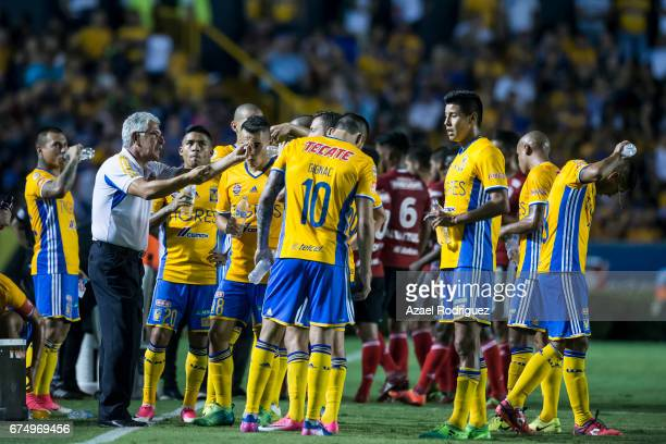 Ricardo 'Tuca' Ferretti coach of Tigres gives instructions to his players during the 16th round match between Tigres UANL and Tijuana as part of the...