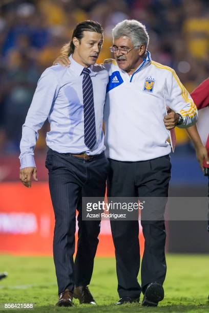 Ricardo 'Tuca' Ferretti coach of Tigres talks to Matias Almeyda coach of Chivas at the end of the 12th round match between Tigres UANL and Chivas as...