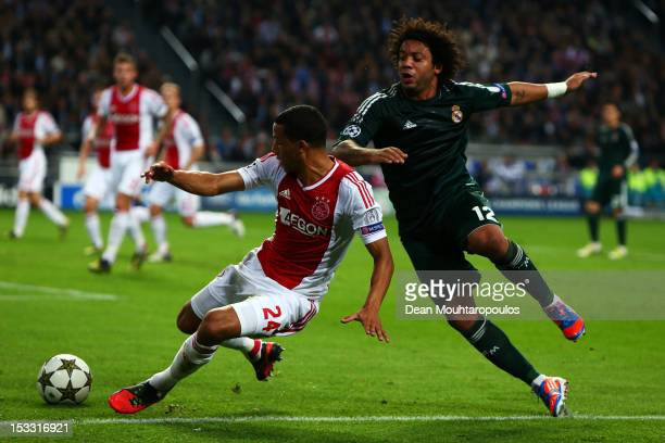 Ricardo Van Rhijn of Ajax and Marcelo of Real battle for the ball during the UEFA Champions League Group D match between Ajax Amsterdam and Real...
