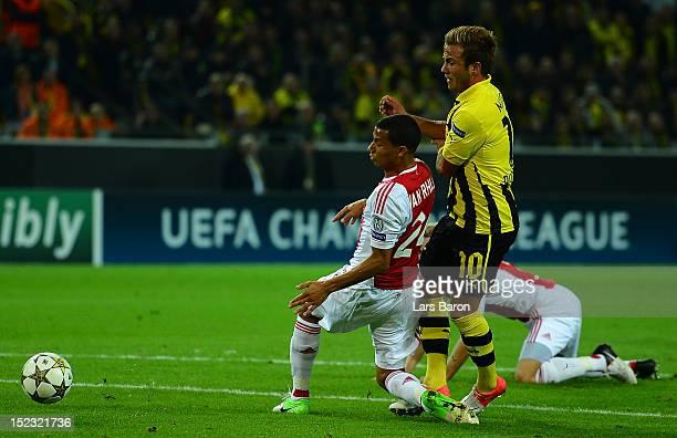 Ricardo van Rhijn of Ajax challenges Mario Goetze of Dortmund in the penalty box during the UEFA Champions League group D match between Borussia...