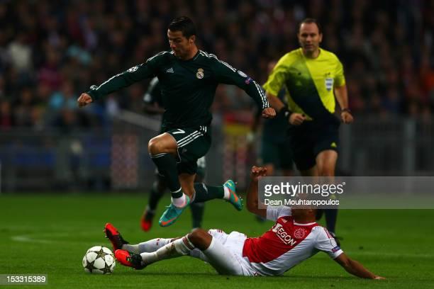 Ricardo Van Rhijn of Ajax tackles Cristiano Ronaldo of Real during the UEFA Champions League Group D match between Ajax Amsterdam and Real Madrid at...