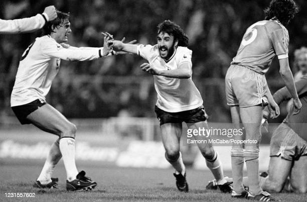 Ricardo Villa of Tottenham Hotspur celebrates with teammate Glenn Hoddle after scoring the winning goal in the FA Cup Final Replay between Tottenham...