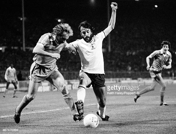 Ricardo Villa of Tottenham Hotspur tackles Gerry Gow of Manchester City during the FA Cup Final Replay at Wembley Stadium in London 14th May 1981...
