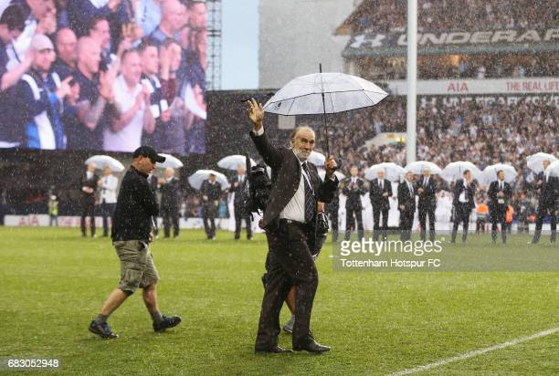 Ricardo Villa walks onto the pitch during the closing ceremony after the Premier League match between Tottenham Hotspur and Manchester United at...
