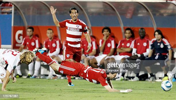Ricardo Villar of the FC Dallas and Stephen Keel of the New York Red Bulls during the first half of a soccer game at Pizza Hut Park on September 17...