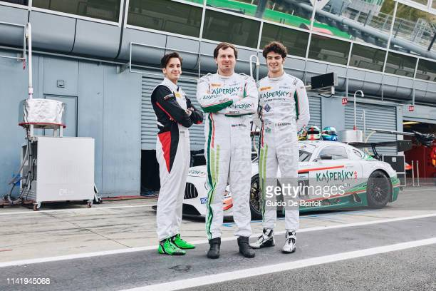 Riccardo Agostini Alexander Moiseev Chief Business Officer at Kaspersky Lab and Alessio Rovera posing with the AMG GT GT3 Mercedes Benz before the...