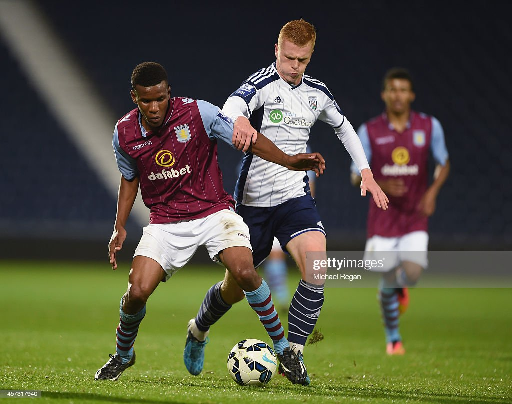 Riccardo Calder of Aston Villa and Ryan Pace of WBA in action during the Barclays U21 Premier League match between West Bromwich Albion and Manchester United at The Hawthorns on October 16, 2014 in West Bromwich, England.