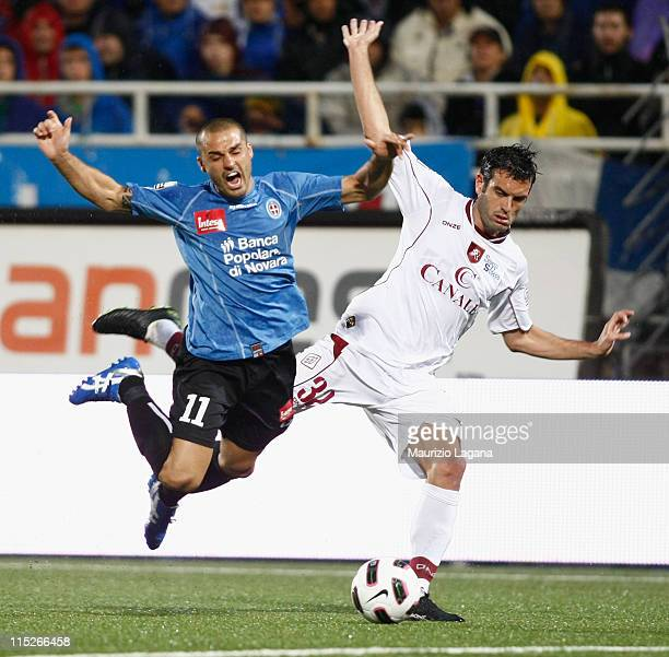 Riccardo Colombo of Reggina competes for the ball with Cristian Bertani of Novara during the Serie B playoff match between Novara Calcio and Reggina...