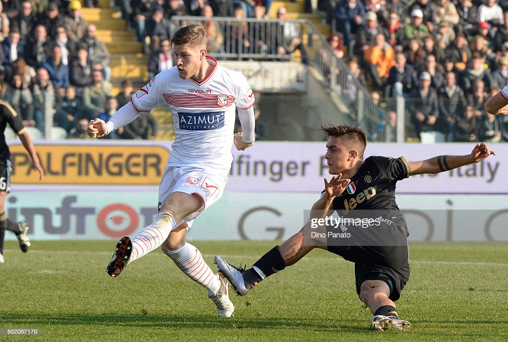Riccardo Gagliolo (L) of Carpi FC competes with Paulo Dybala of Juventus FC during the Serie A match between Carpi FC and Juventus FC at Alberto Braglia Stadium on December 20, 2015 in Modena, Italy.