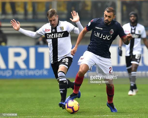 Riccardo Gagliolo of Parma Calcio and Danilo of Bologna FC in action during the Serie A match between Parma Calcio and Bologna FC at Stadio Ennio...
