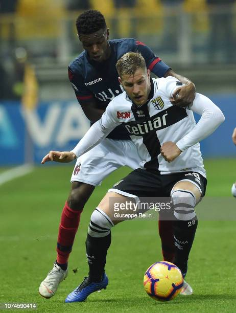 Riccardo Gagliolo of Parma Calcio and Ibrahim Mbaye of Bologna FC in action during the Serie A match between Parma Calcio and Bologna FC at Stadio...