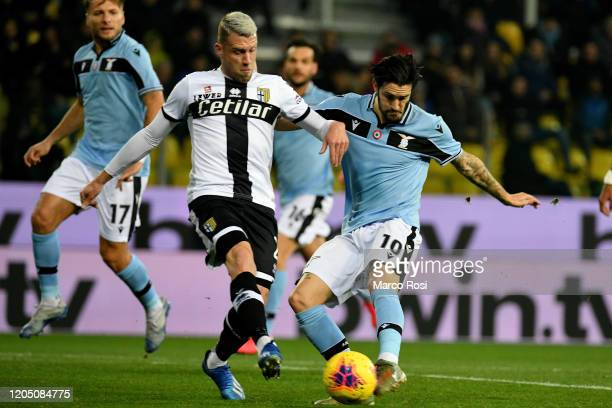 Riccardo Gagliolo of Parma Calcio compete for the ball with Luis Alberto of SS Lazio during the Serie A match between Parma Calcio and SS Lazio at...