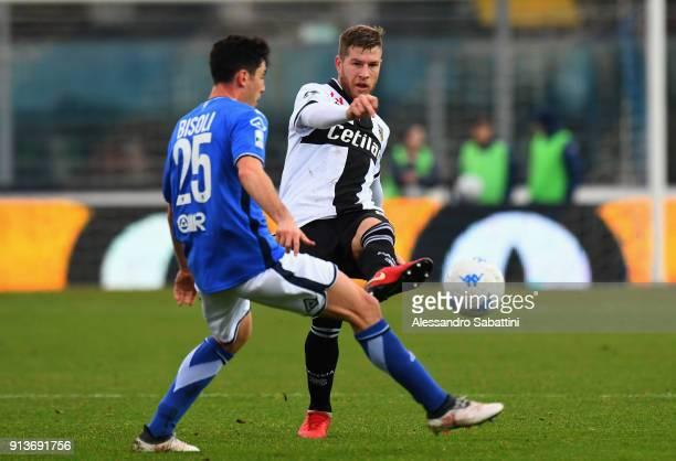 Riccardo Gagliolo of Parma Calcio competes for the ball whit Dimitri Bisoli of Brescia Calcio during the Serie B match between Brescia Calcio and...