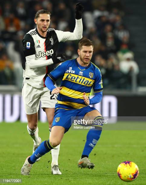 Riccardo Gagliolo of Parma Calcio competes for the ball with Adrien Rabiot of Juventus FC during the Serie A match between Juventus and Parma Calcio...