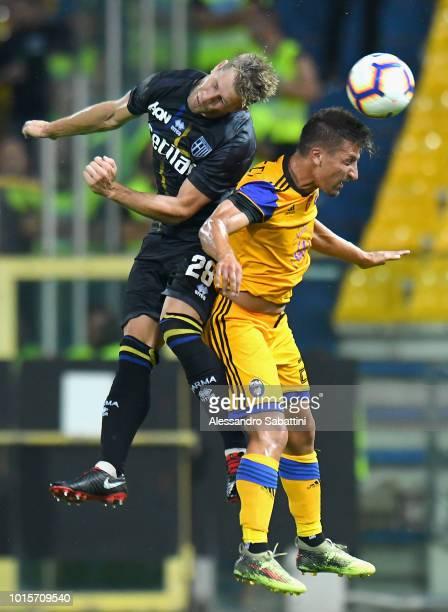 Riccardo Gagliolo of Parma Calcio competes for the ball with Gaetano Masucci of Pisa during the Coppa Italia match between Parma Calcio and Pisa at...
