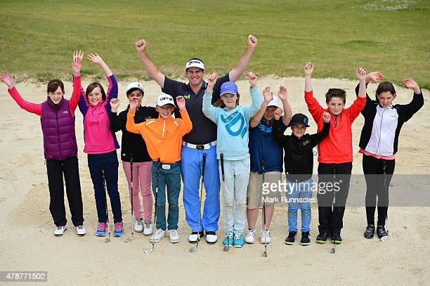 Riccardo Gouveia of Portugal giving local children a bunker lesson during the third round of the 2015 SSE Scottish Hydro Challenge at the MacDonald...
