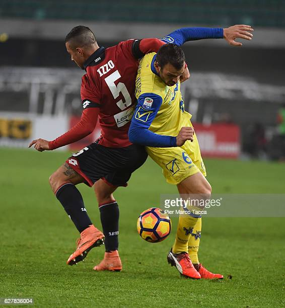Riccardo Meggiolini of AC ChievoVerona competes for the ball with Armando Izzo of Genoa CFC during the Serie A match between AC ChievoVerona and...
