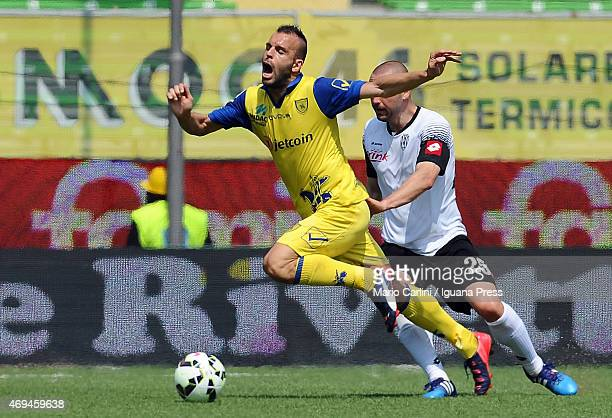 Riccardo Meggiorini of AC Chievo Verona is fouled by Daniele Capelli of AC Cesena during the Serie A match between AC Cesena and AC Chievo Verona at...