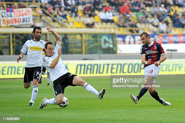Riccardo Meggiorini of Bologna competes with Steve Von Bergen of Cesena during the Serie A match between Bologna FC and AC Cesena at Stadio Renato...