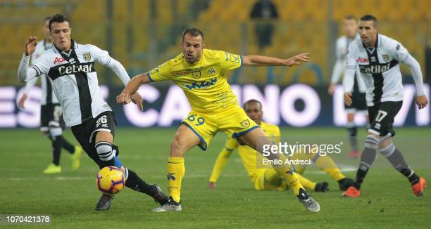 Riccardo Meggiorini of Chievo Verona competes for the ball with Luca Siligardi of Parma Calcio during the Serie A match between Parma Calcio and...