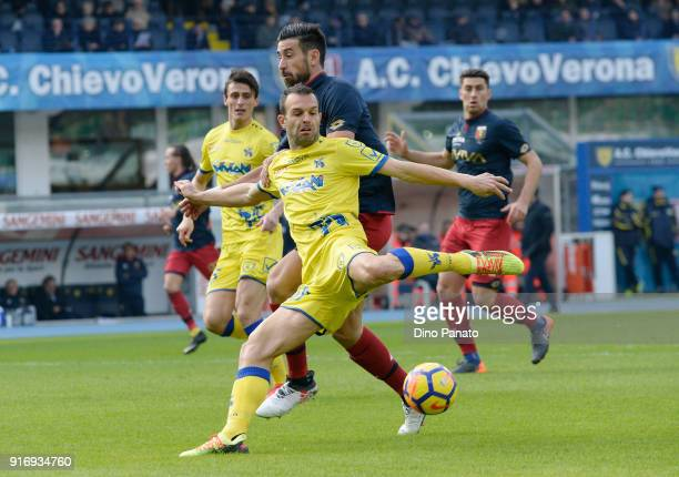 Riccardo Meggiorini of Chievo Verona competes with Davide Biraschi of Genoa during the serie A match between AC Chievo Verona and Genoa CFC at Stadio...