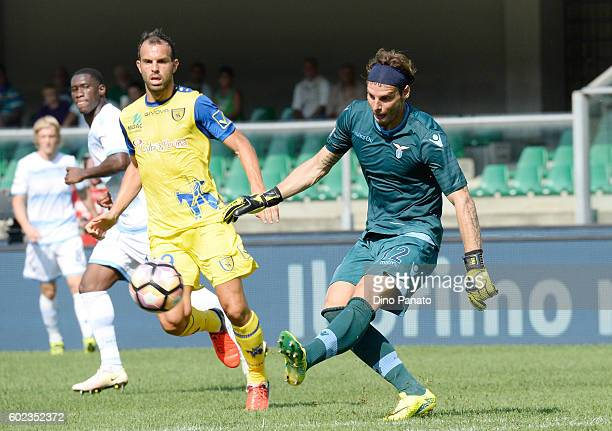 Riccardo Meggiorini of Chievo Verona competes with Federico Marchetti goalkeeper of SS Lazio during the Serie A match between AC Chievo Verona and SS...