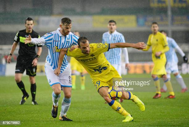 Riccardo Meggiorini of Chievo Verona competes with Francesco Viccari of Spal during the Serie A match between AC Chievo Verona and Spal at Stadio...