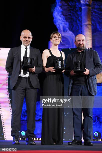 Riccardo Milani Paola Cortellesi and Antonio Albanese are awarded during the Nastri D'Argento Award Ceremony on June 30 2018 in Taormina Italy