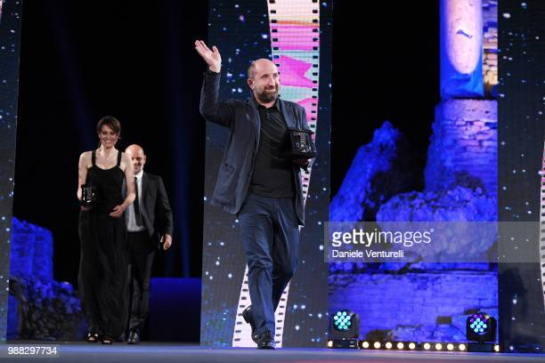 Riccardo Milani, Paola Cortellesi and Antonio Albanese are awarded during the Nastri D'Argento Award Ceremony on June 30, 2018 in Taormina, Italy.