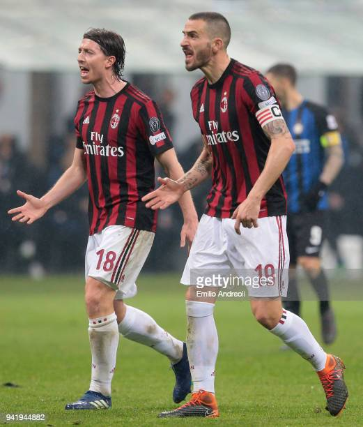 Riccardo Montolivo and Leonardo Bonucci of AC Milan react during the serie A match between AC Milan and FC Internazionale at Stadio Giuseppe Meazza...