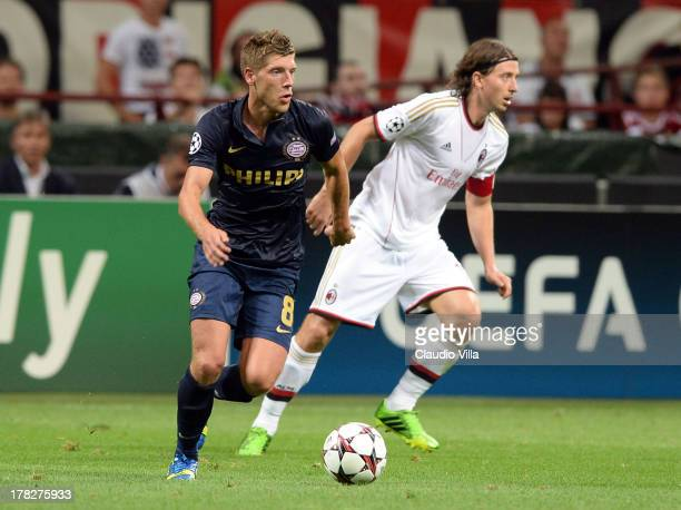 Riccardo Montolivo of AC Milan and Stijn Schaars of PSV compete for the ball during the UEFA Champions League Playoff Second Leg match between AC...