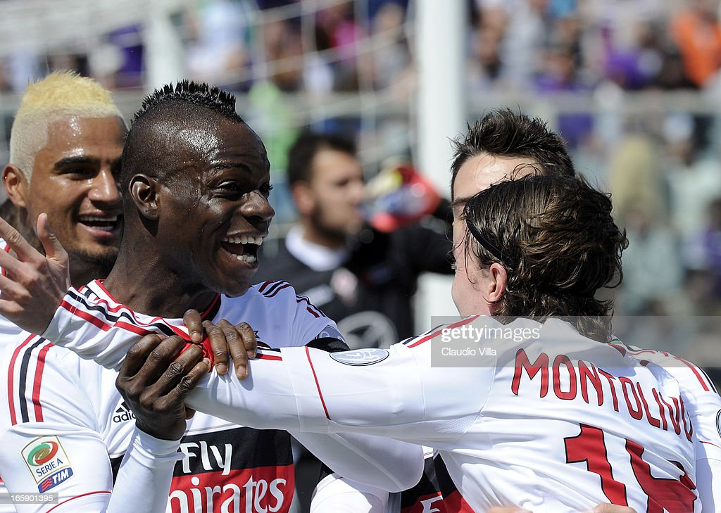 Riccardo Montolivo (R) of AC Milan celebrates after scoring his team's first goal with his team mate Mario Balotelli during the Serie A match between ACF Fiorentina and AC Milan at Stadio Artemio Franchi on April 7, 2013 in Florence, Italy.