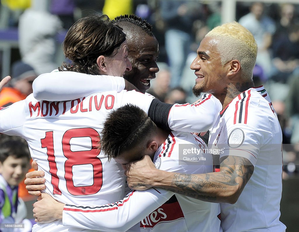 Riccardo Montolivo (L) of AC Milan celebrates after scoring the first goal during the Serie A match between ACF Fiorentina and AC Milan at Stadio Artemio Franchi on April 7, 2013 in Florence, Italy.